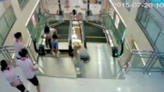getlinkyoutube.com-Man watches wife die in China escalator accident