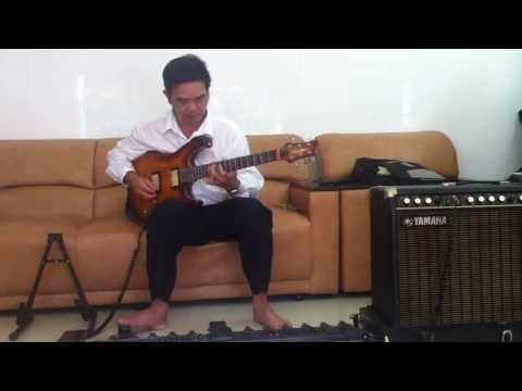 Nhat Long doc tau tau guitar co  bai nam xuan