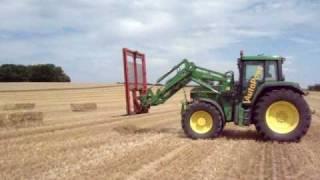 www.tractorfoto.tk- stro laden met de John Deere 6910S+John Deere 740A frontlader
