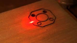 Low cost CNC cuts balsa using DVD laser