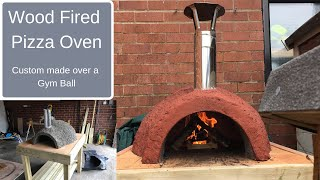 getlinkyoutube.com-Wood Fired Pizza Oven made over a gym ball using Vermiculite and cement mix