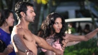 What is Veena Malik doing with Ashmit Patel in a swimming pool