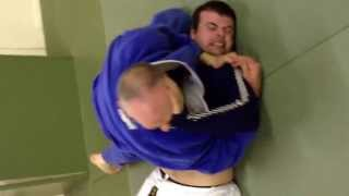 Father and son grappling.