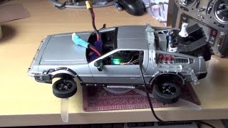 getlinkyoutube.com-FPV drone racing - RC flying DeLorean prototype Back to the future for Universal Studios show??