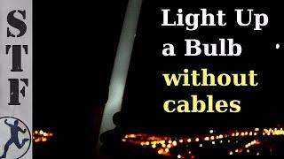getlinkyoutube.com-Light up a Bulb Under High Voltage Power Lines