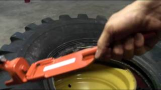 getlinkyoutube.com-Pneu-Tek Universal Impact Driven Demounter on Grader Tire [Model 20408]