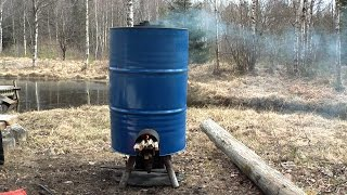 getlinkyoutube.com-Simple DIY rocket stove producing hot water/food and charcoal part 2