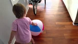 Charlotte playing with beach ball
