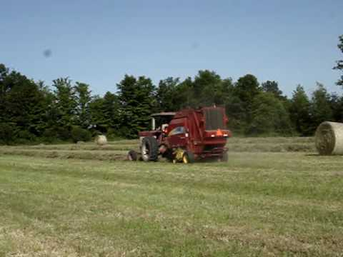 Round Baleing First Field With New Baler