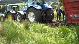 getlinkyoutube.com-Tractor and trailer struck in mud.