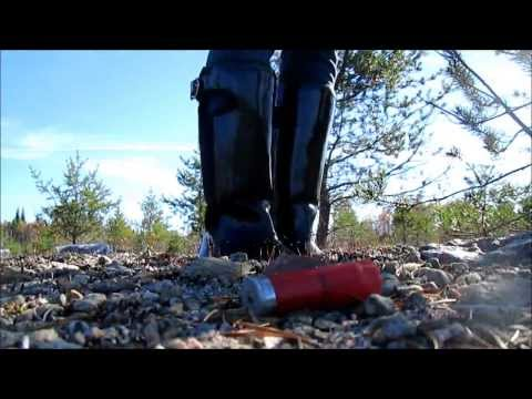 Rubber riding boots trample empties shells from shotgun