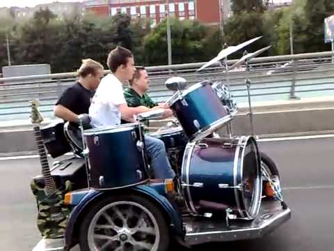 Rock Band Plays on Top of Speeding Motorcycle