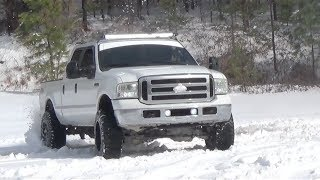 getlinkyoutube.com-Lifted F250 Powerstroke Playing In The Snow