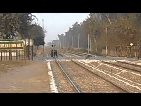 Pakistan Railways: Pak Business Express rushing past Green Town, Lahore Suburbs
