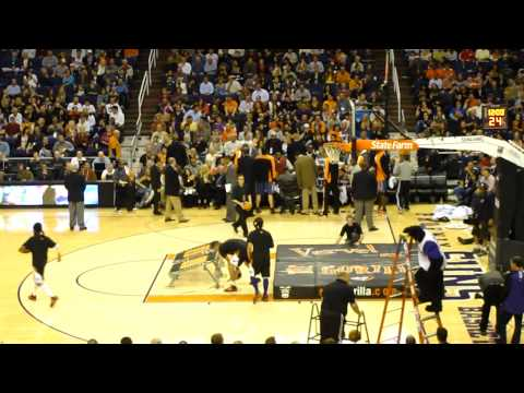 Guy dunks himself through basketball hoop, Phoenix Suns Gorilla Sol Patrol