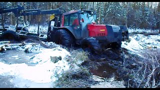 getlinkyoutube.com-Valtra forestry tractor in wet forest, difficult conditions