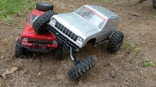 getlinkyoutube.com-Two RC Jeep Cherokee XJ Rock Crawler 4x4 Trucks Axial SCX10 Honcho And Exceed Mad Torque