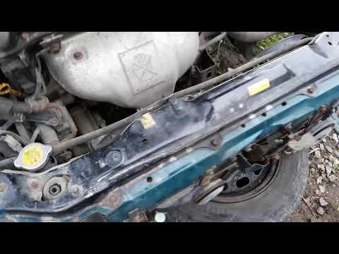 Снятие бампера и радиаторов Mazda 323f BA 95г