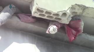 getlinkyoutube.com-SYRIA WOman crushed to death from a building collapsing     Mujer muere aplastada por un edificio de