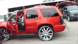 "CHEVY TAHOE ON 30 "" ASANTI'S WITH THE BIG SCREEN TV GOING UP & DOWN"