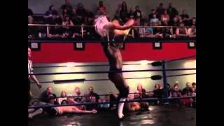 Black Wrestler Puts a Brutal Back Breaker On a Female Wrestler