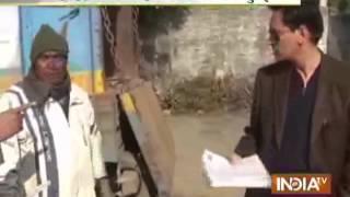 getlinkyoutube.com-Haldwani DM's Gunman Slaps Old Man - India TV