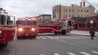 getlinkyoutube.com-FDNY Tiller Ladder 34 Taking Up From A High Rise Fire In Harlem With Cool Tiller Maneuvers
