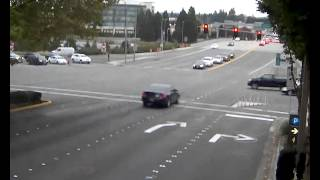 Watch: Distracted Bellevue driver runs light, causes crash