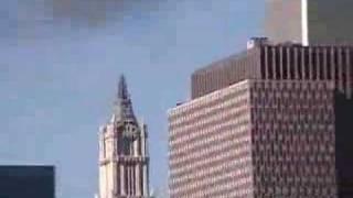 getlinkyoutube.com-Rooftop view of 2nd plane hitting South Tower, loud boom...