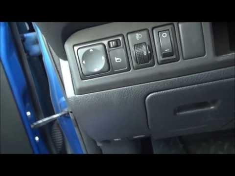 Nissan Note 1.6 Кнопка отключения омывателя фар.