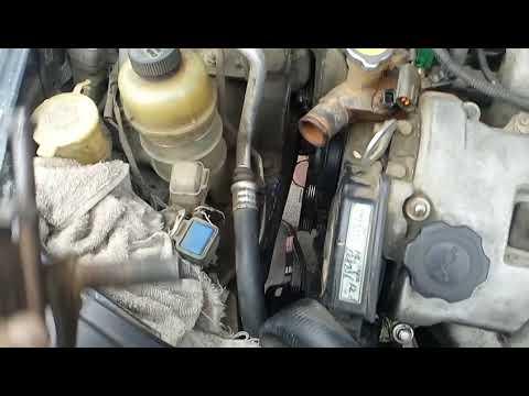 Mazda Xedos 9, как снять кронштейн, с натяжным роликом ремня генератора