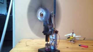 getlinkyoutube.com-Stirling engine powering lights from a small flame