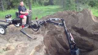 getlinkyoutube.com-Digging the Pond with the towable backhoe
