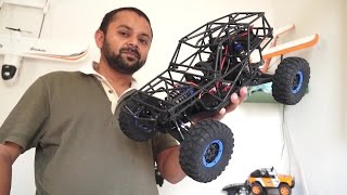 getlinkyoutube.com-WLtoys 10428A RC Electric 4WD Wild Truck Indoor Review