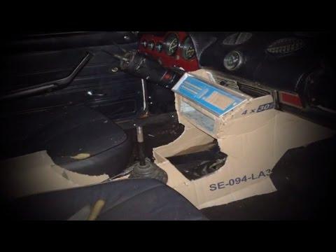 Где находится у Mazda Капелла датчик открывания двери