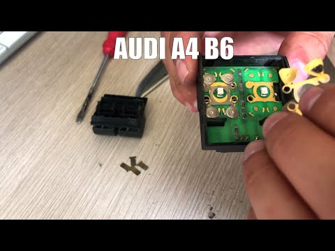 Где находится кнопка стеклоподъемника в Audi SQ5