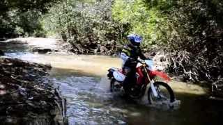 getlinkyoutube.com-CRF 250L water crossing and a jump