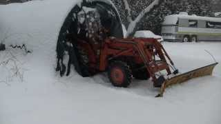 getlinkyoutube.com-Plowing with the Homemade tractor snow plow mount