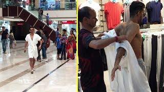 Shopping In Bathrobe   by Vinay Thakur