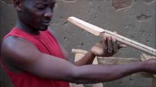 getlinkyoutube.com-Guitar Maker at Dzaleka Refugee Camp, Malawi