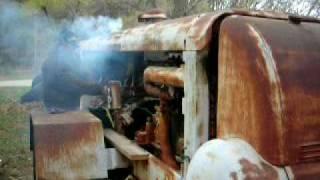 getlinkyoutube.com-Caterpillar starting an antique compressor