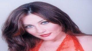 getlinkyoutube.com-انهيار جيهان فاضل في عزاء زوجها...وشاهد صورها مع اولادها ومعه