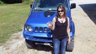 Blonde girl going off road with Monster Suzuki Jimny ( bigfoot )