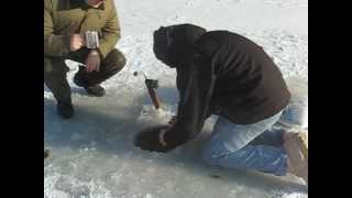 getlinkyoutube.com-Catching a fish as BIG as me while ice fishing, reeling it in by hand.