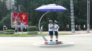 getlinkyoutube.com-Pyongyang Traffic Lady Changing of the Guard
