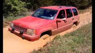 "getlinkyoutube.com-93 Jeep Grand Cherokee ZJ playing in some mud. 4"" RC ""X"" Series lift"