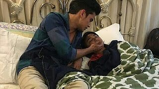 James trying to wake up Nadine on the set