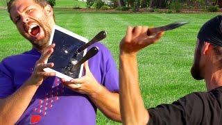 "getlinkyoutube.com-How Far Away Can World Champion Knife Thrower Hit iPad Pro 9.7""? - Gizmoslip"