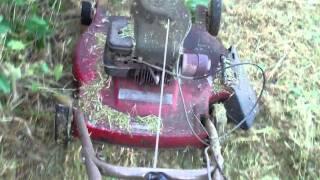 getlinkyoutube.com-Modified lawnmower to cut high tall grass