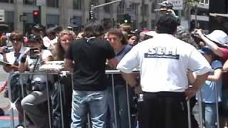 Rupert Grint\'s brother James signing at the Hand/Wand/Foot Ceremony